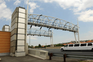 A motor vehicle passes through an e-toll gantry. Sapa