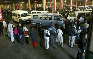Commuters stand in a long queue at the Bree taxi Rank because of the Metro bus drivers strike , Johannesburg. Image by: ANTONIO MUCHAVE.